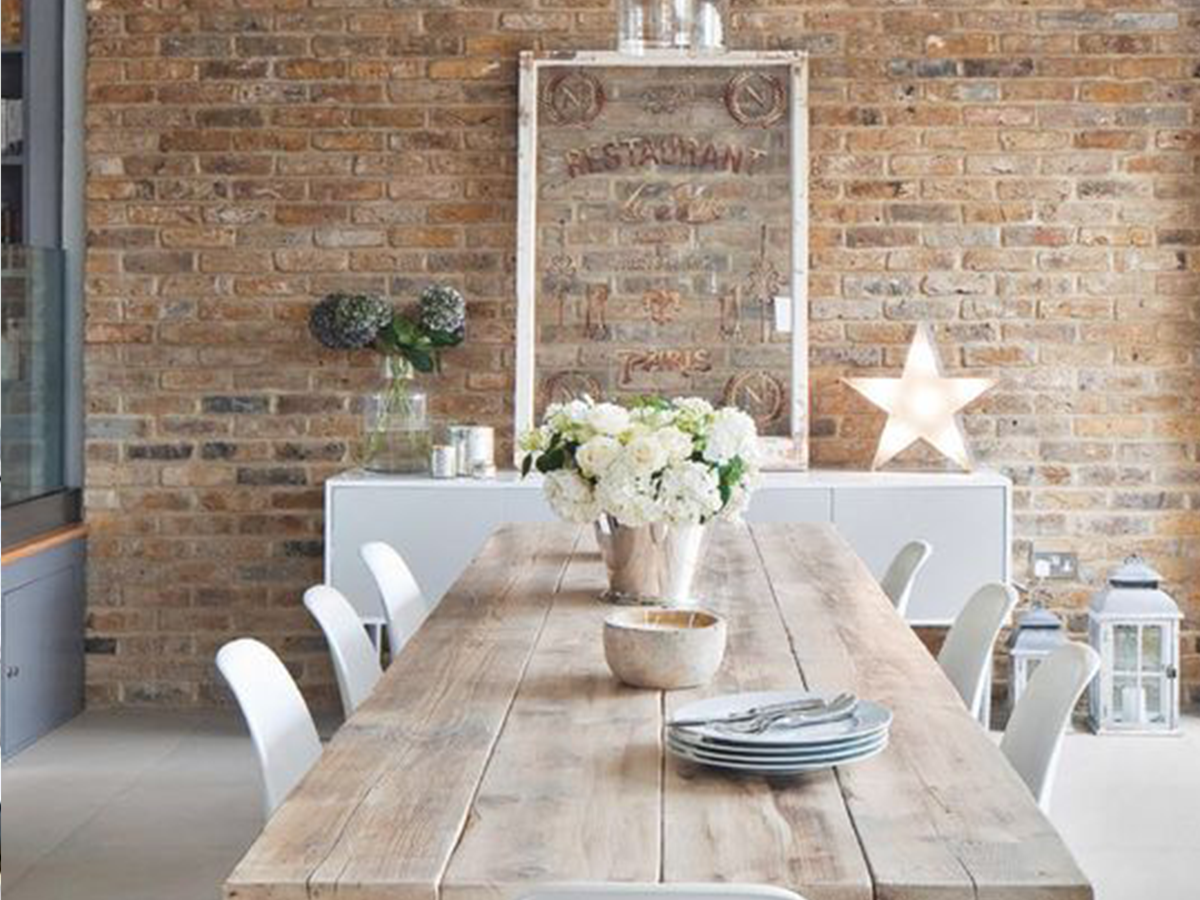 modern rusting dining table and white chairs